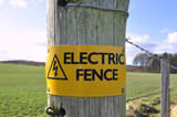 Electric Fence Sign in the Countryside