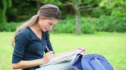Cheerful student doing her homework