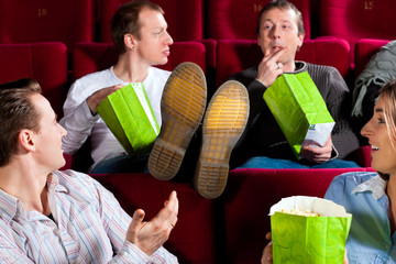People in cinema theater eating porcorn