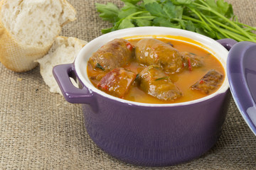 Goulash - Hungarian sausage stew served freshly baked bread