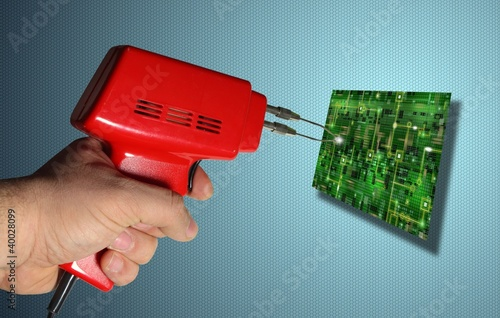 Soldering iron with an electronic board