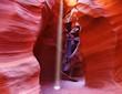 A thin ray of sunlight illuminates the canyon