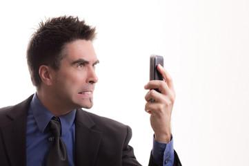 Wütendenden Geschäftsmann nervt Telefon