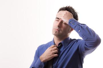 Businesmann mit Kopfschmerzen