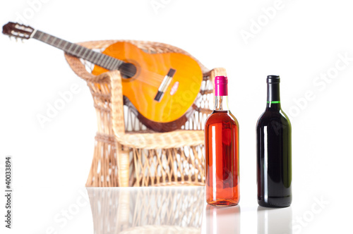 Rose and red wine bottle with a guitar on background