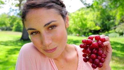 Smiling woman holding grape fruit
