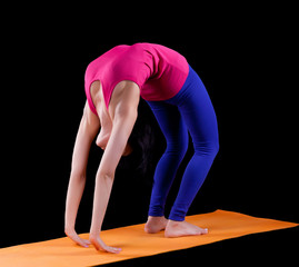 Woman exercise bridge yoga asana  on orange mat