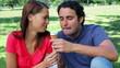 Joyful couple eating ice creams