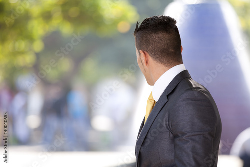 Modern businessman at the city park