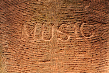 Music word engraved on a limestone wall