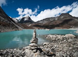 Balance: Stone stack and Sacred Lake near Gokyo