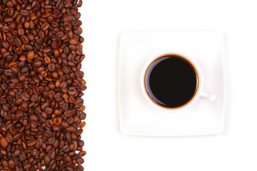coffee beans and a cup of black coffee on white