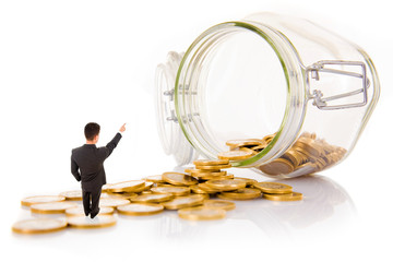 Young business man and coins, isolated on white