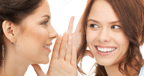 two women spreading gossip