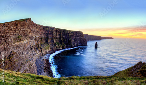 Panoramic view of Cliffs of Moher at sunset in Ireland.