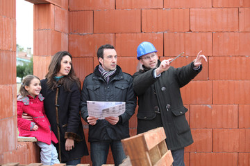 Family being shown around their new home