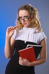 Blondy model girl in office