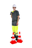 Laborer with traffic cones