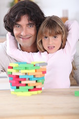 Father with daughter and puzzle
