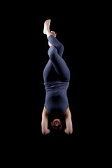 Woman - dark dress stand on hands in yoga pose