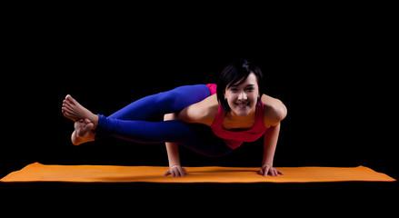 Woman exercise yoga asana - arm balance