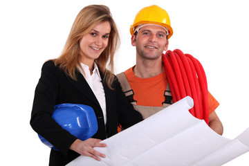 Tradesman conferring with an engineer