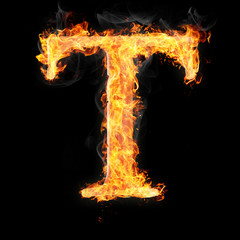 Fonts and symbols in fire on black background - T