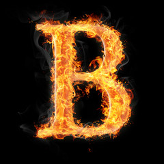 Fonts and symbols in fire on black background - B
