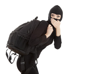 female thief in black balaclava with stolen rucksack