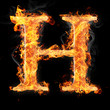 Fonts and symbols in fire on black - H