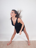 Dancer in black outfit, dancing with pleasure poster