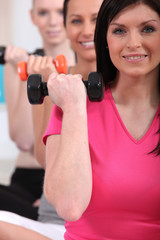 Women working out with dumbbells