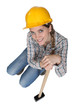 Pretty woman posing with sledge hammer