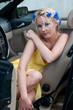 Shot of beautiful woman sitting in car