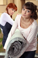 Women with a roll of carpet