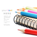 Fototapety Colorful pencils and notebook isolated over white