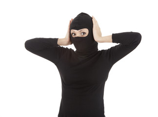 female thief in black balaclava and mask covering ears