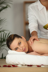 Happy woman being massage in beauty parlor
