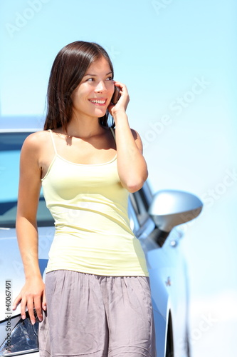 Woman on phone by car
