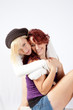 blond and redhead girls playing together