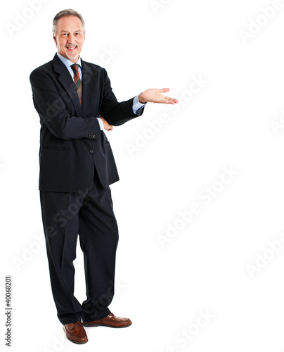 Businessman welcoming you isolated on white