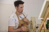 artist painting model at art studio poster