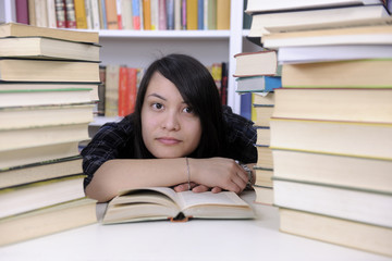 Student with books in a library