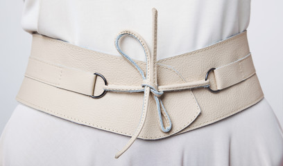 Fashion. Women's beige leather wide belt with lacing