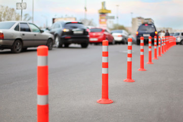 protective barrier made of red striped columns on road