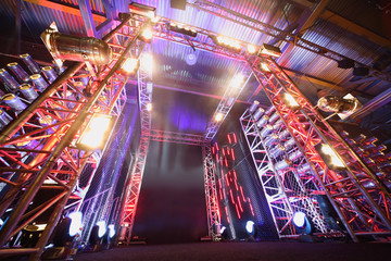 Illuminated way to boxing ring inside fight club