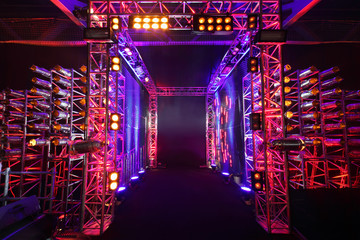 Multi-colored illuminated way with grid to boxing ring