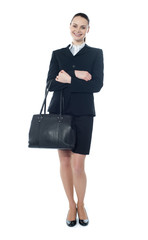 Full length of businesswoman with handbag