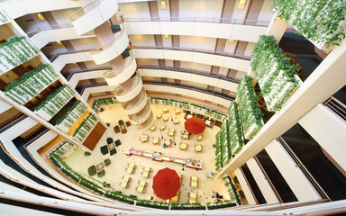 Stories in hotel, spiral staircase connects all floors
