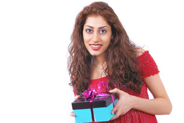 Cute smiling female holding a gift-box, with copy space